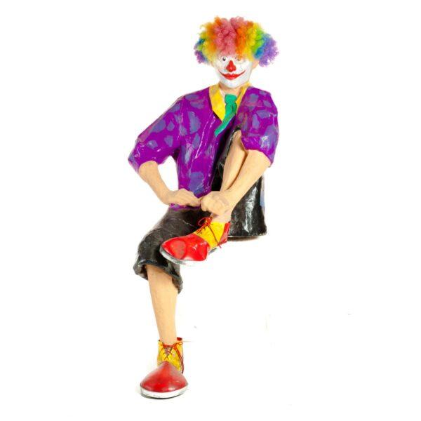 Life Size Clown Sitting on Plinth