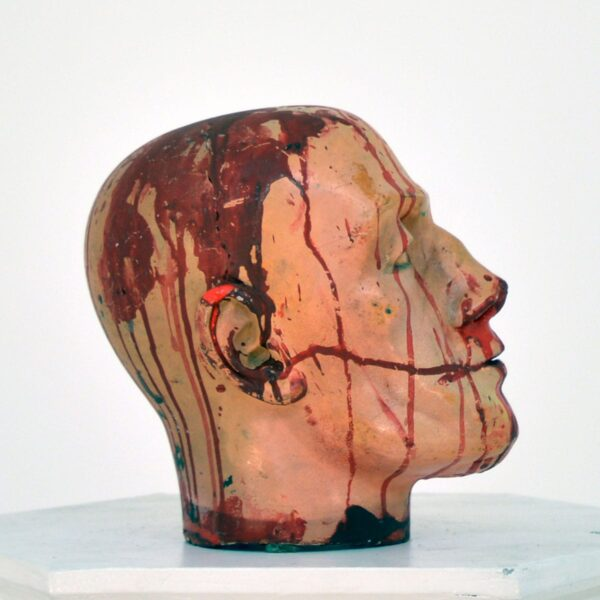 Horror severed head with blood splatters