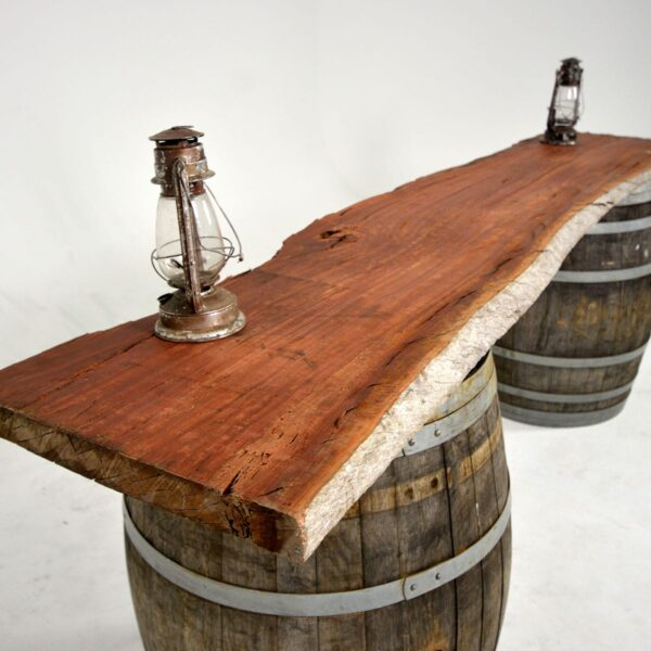 Raw Timber Table Top on Two Barrels - Sydney Prop Specialists - Prop Hire and Event Theming