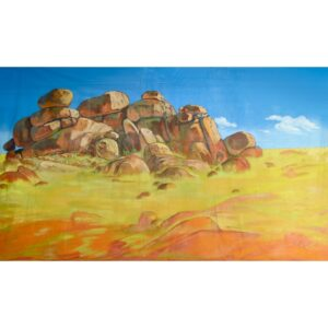 Depicts a outcrop of rocks in an arid region of Australia